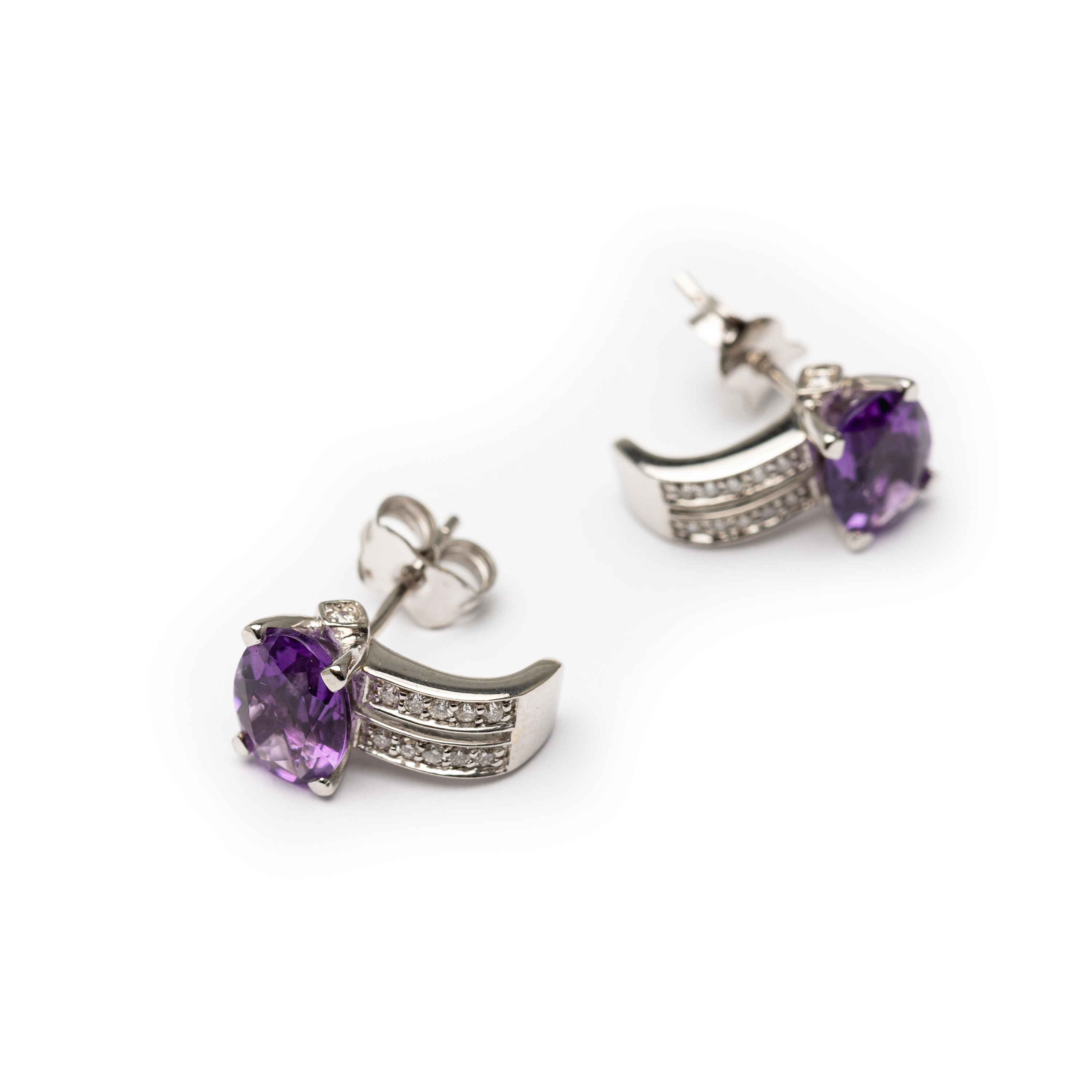 18kt White Gold Amethyst And Zirconia Earrings.