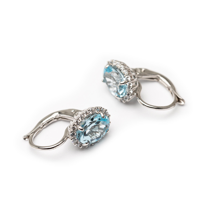 18kt White Gold Cluster Earrings.