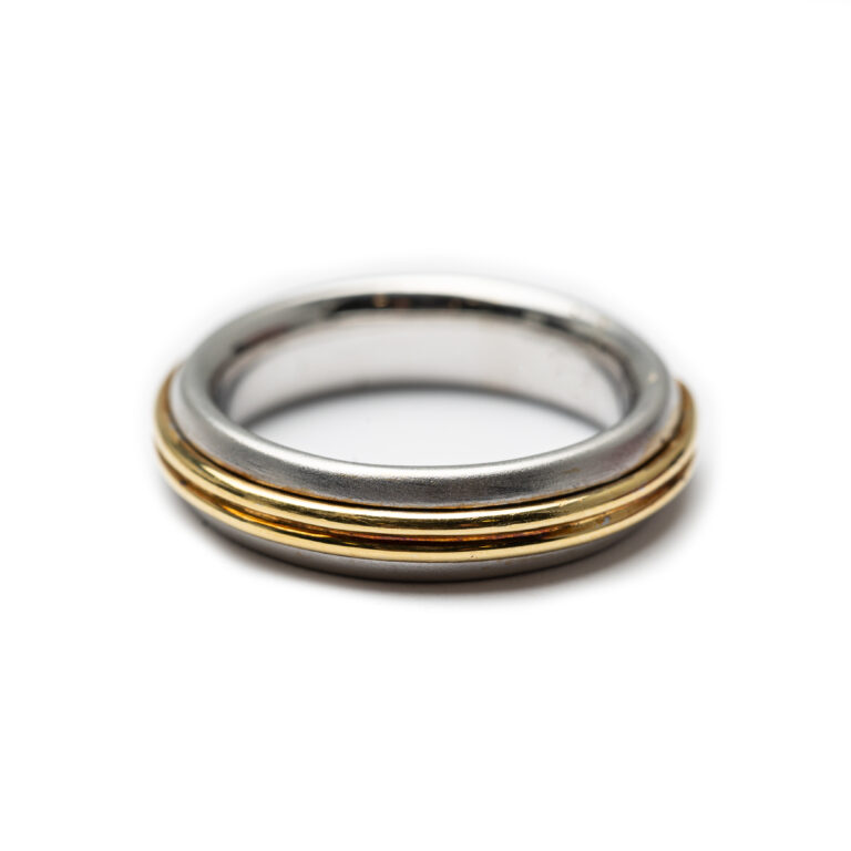 18kt Yellow And White Gold Wedding Band .